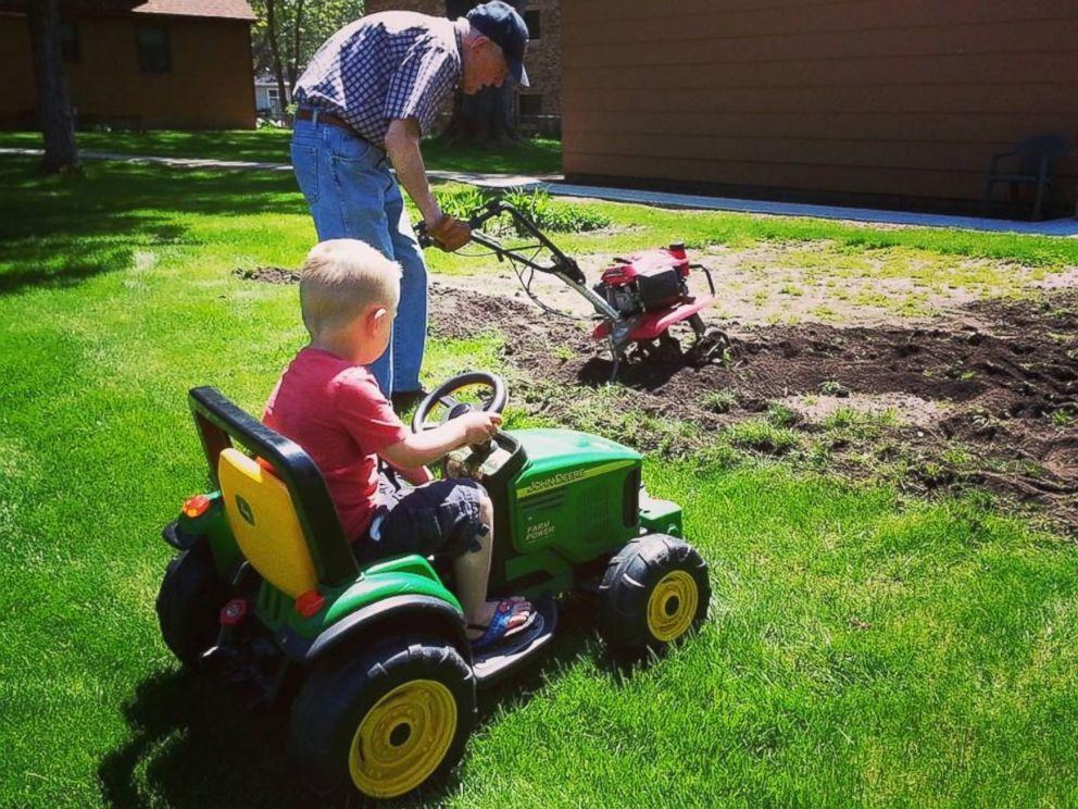 PHOTO: Erling, left, and Emmett tilling the garden together.