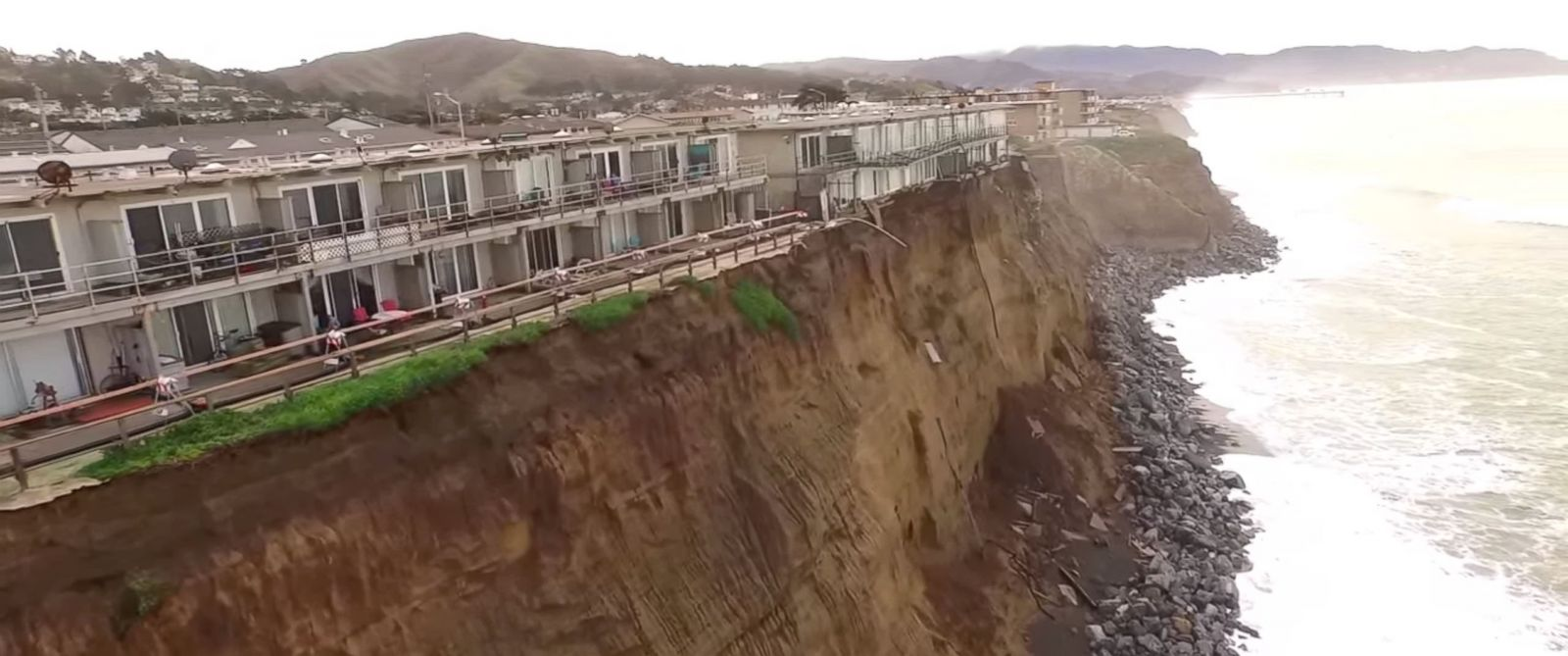 "PHOTO: An image made from a video posted to YouTube on Jan. 25, 2016 with the title ""Pacifica Coastal Erosion Drone Video"" shows the extent of the damage done from El Nino storms. Residents have been ordered out of these apartments."