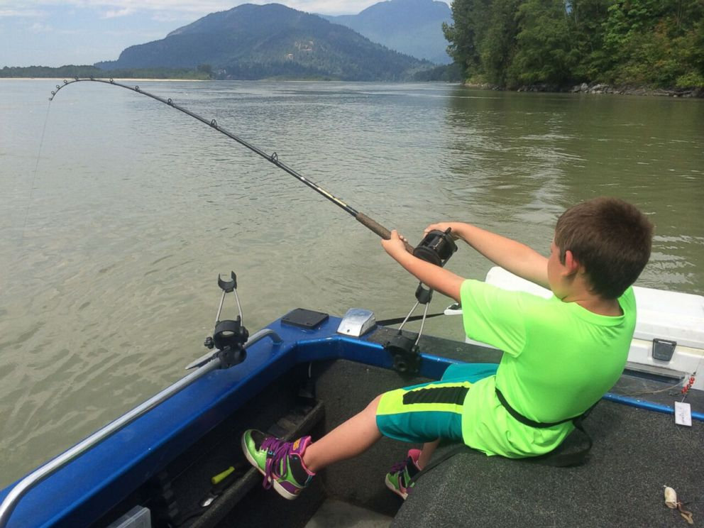 9 Year Old Boy Reels In 600 Pound Sturgeon And There S
