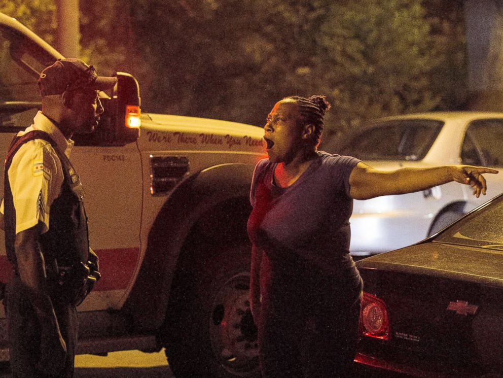PHOTO: A woman talks to police near the scene where a man was shot in the leg near 87th and Morgan, in Chicago, July 6, 2014.