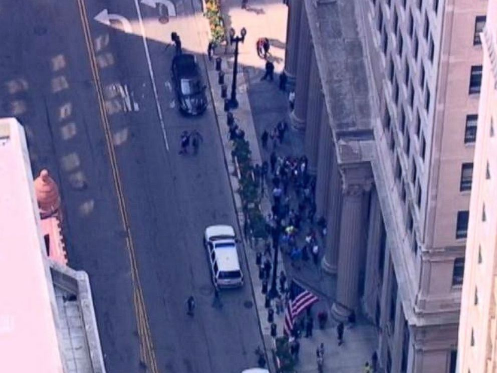 PHOTO: People gather outside 231 South Lasalle St. in Chicago following a shooting inside