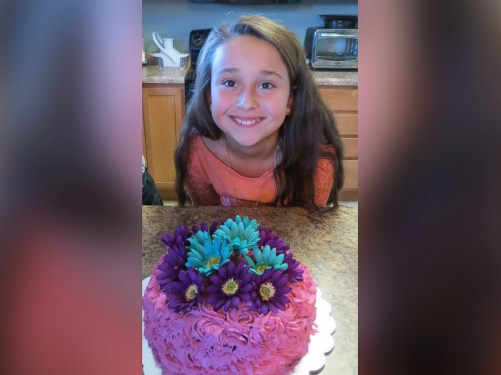 PHOTO: Chloe Stirling smiles for a photo with a cake she made.
