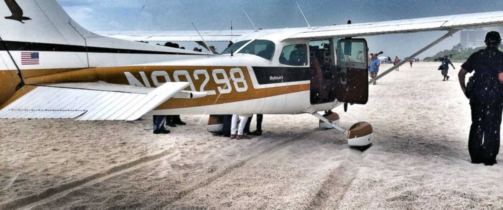 """PHOTO: Miami Beach Police tweeted this photo, July 29, 2014, with the text, """"#Plane makes emergency landing on beach right before storm.Pilot & 3 passengers safe. No injuries mechanical failure."""""""