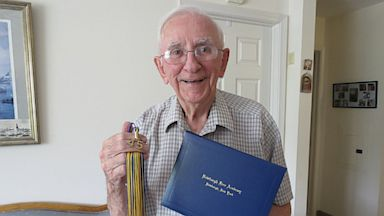 PHOTO: George Whalen celebrates graduation 68 years later.