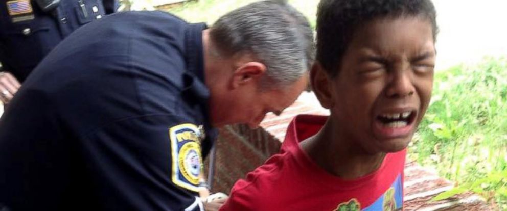 PHOTO: Sean, 10, is handcuffed by police outside his Columbus, Georgia home on April 28, 2015.