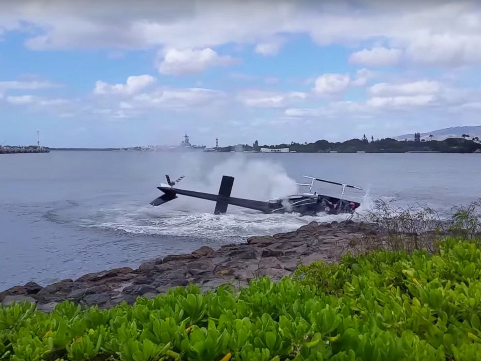 PHOTO: A helicopter crashed near the USS Arizona memorial, Feb. 18, 2016, in Pearl Harbor, Hawaii.