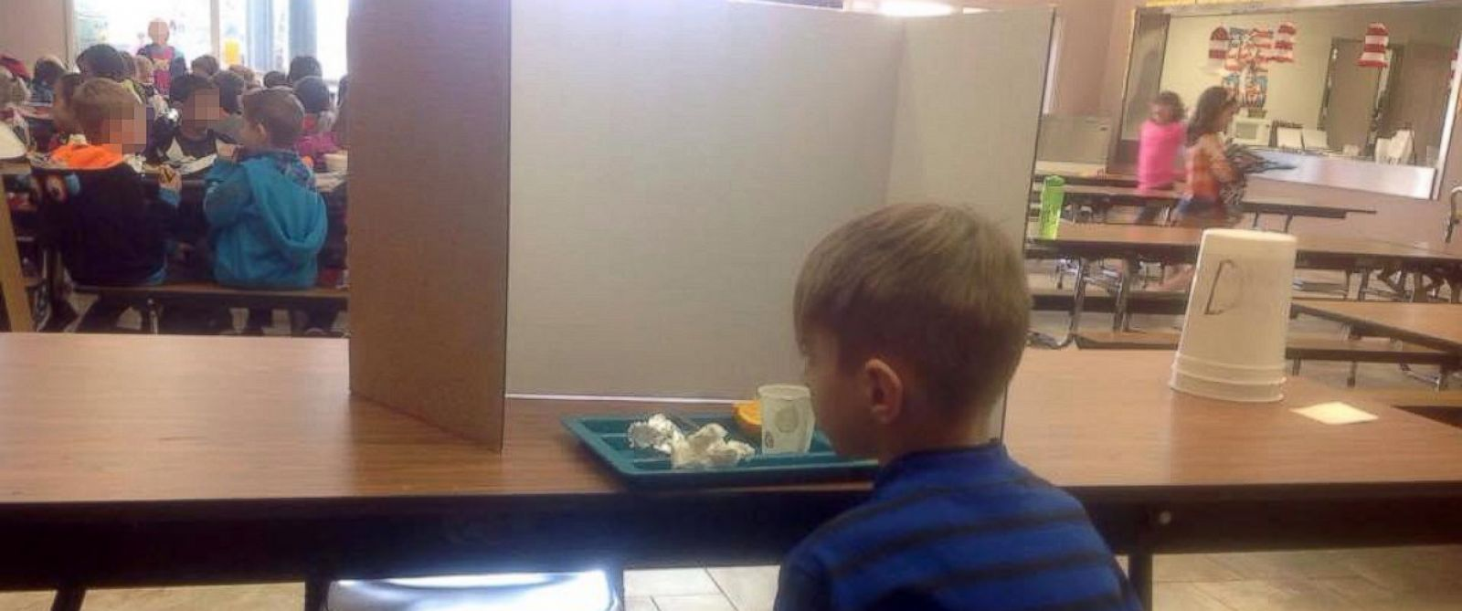 PHOTO: First grader Hunter Cmelo, 6, sits by himself at lunch because he was late to school.