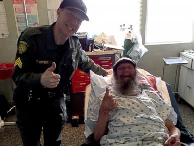 PHOTO: This photo provided by the Washoe County Sheriffs Office shows Sgt. Dennis Hippert and Philip Besanson at a hospital in Cedarville, California.