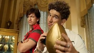 PHOTO: Eli and Peyton Manning star in a DIRECTV ad.