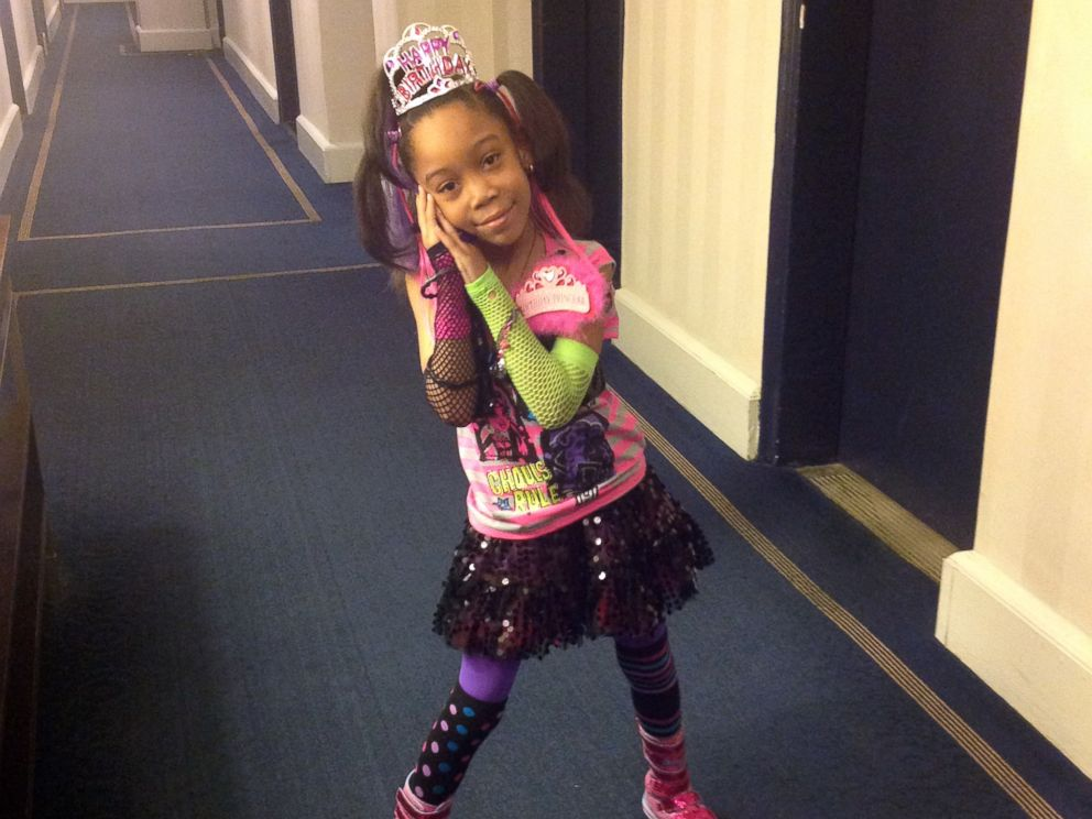 Najh'ja poses on her 7th birthday in the hallway of the Manhattan hotel where she has been living with her family.