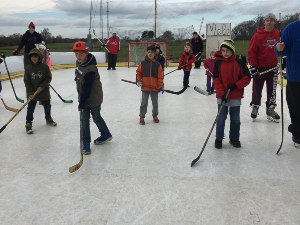 PHOTO:Kids play on Mels Rink. The rink, in Maryland resident Marc Kohns backyard, is in danger of having to be taken down because its not in compliance with local laws.