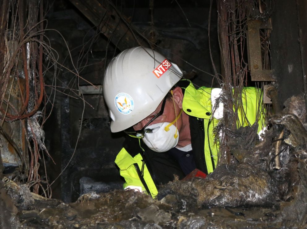 PHOTO: In this photo posted to Flickr by the National Transportation Safety Board, an inspector examines inside a burned unit from the Metro-North accident.