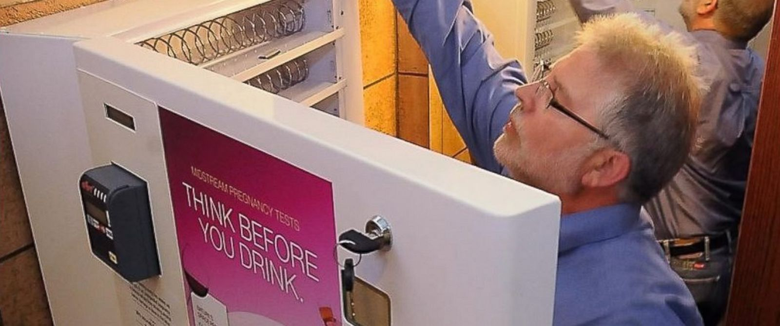 PHOTO: Jody Allen Crowe, executive director of Healthy Brains for Children, installed the first-of-its-kind pregnancy test dispenser in the womens restroom at Pub 500 in Mankato, Minn. in 2012.