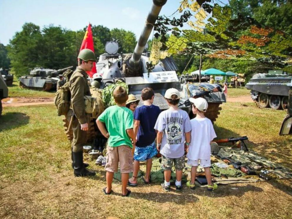 PHOTO: Kids check out the gear at a military simulation event in 2001 in Virginia.