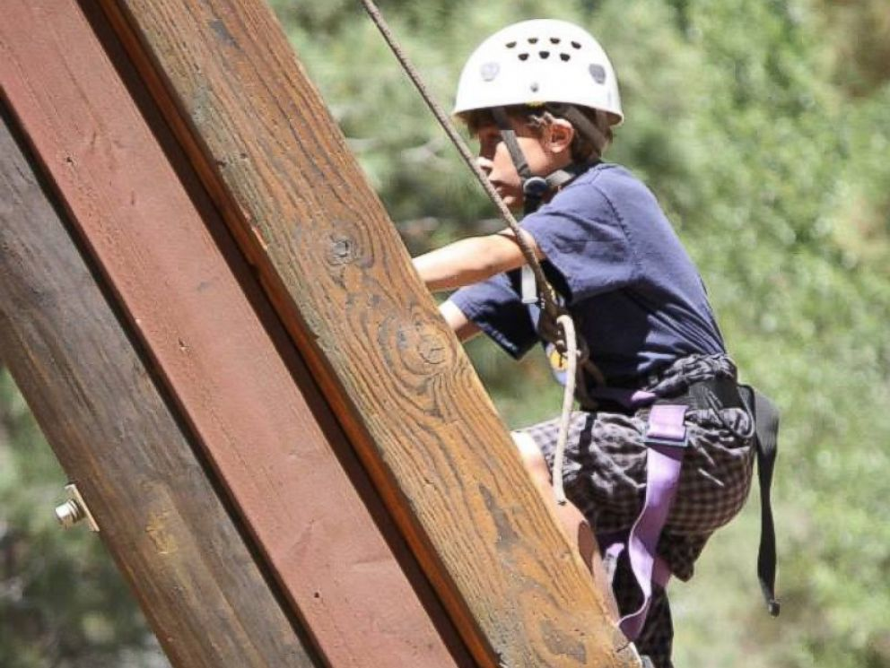 PHOTO: A climber at Camp To Belong, which reconnects foster and adopted children with their siblings.