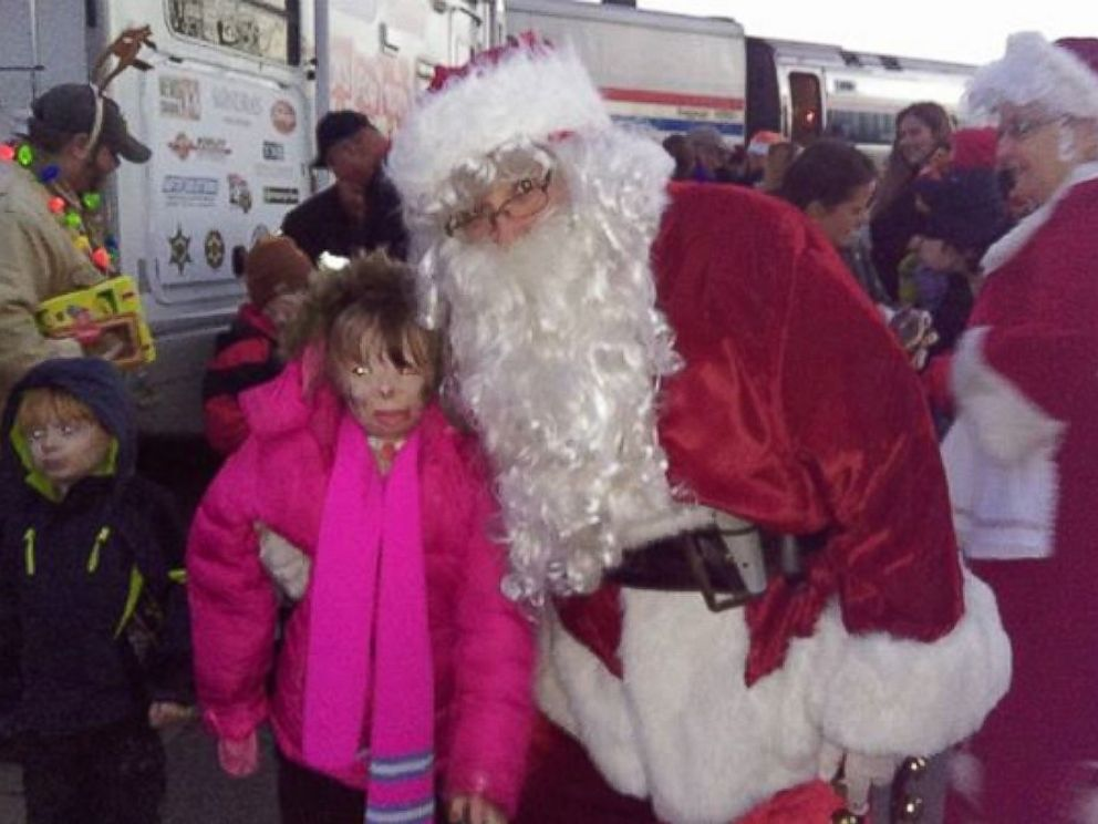 PHOTO: Safyre, 8, posed with Santa at a Toys for Tots event on Dec. 5.