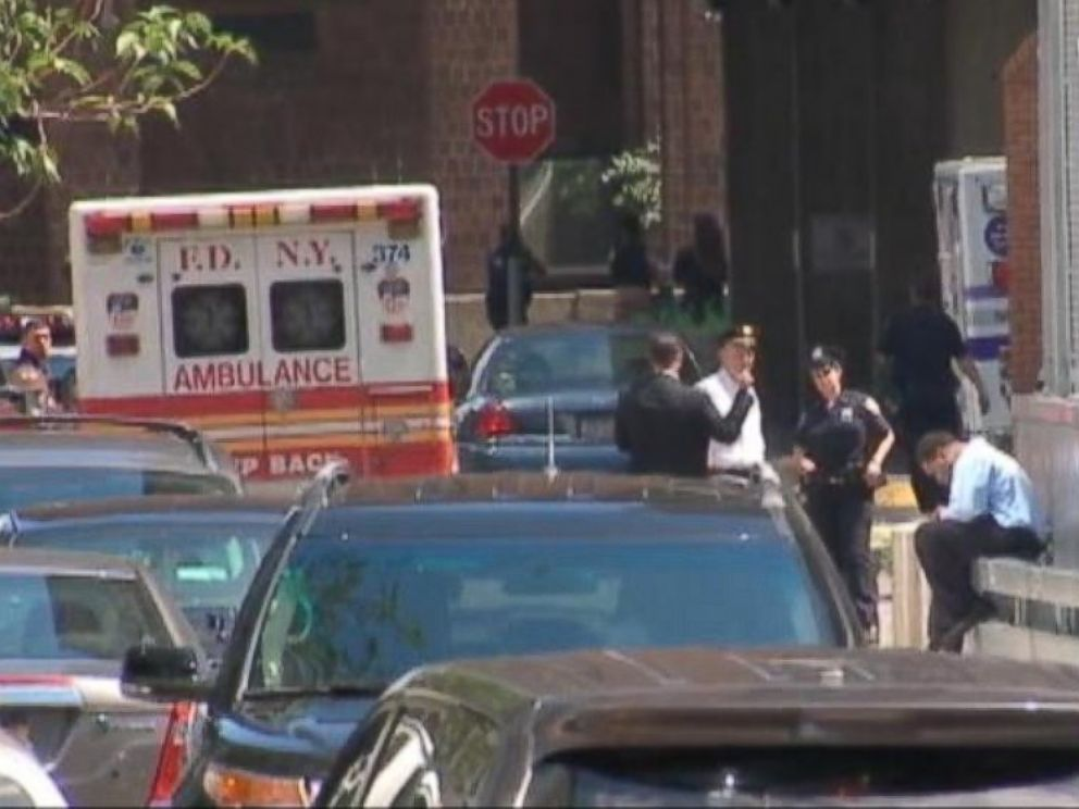 PHOTO: An ambulance sits near the scene of a fatal shooting involving a fugitive in New York City, July 28, 2014.