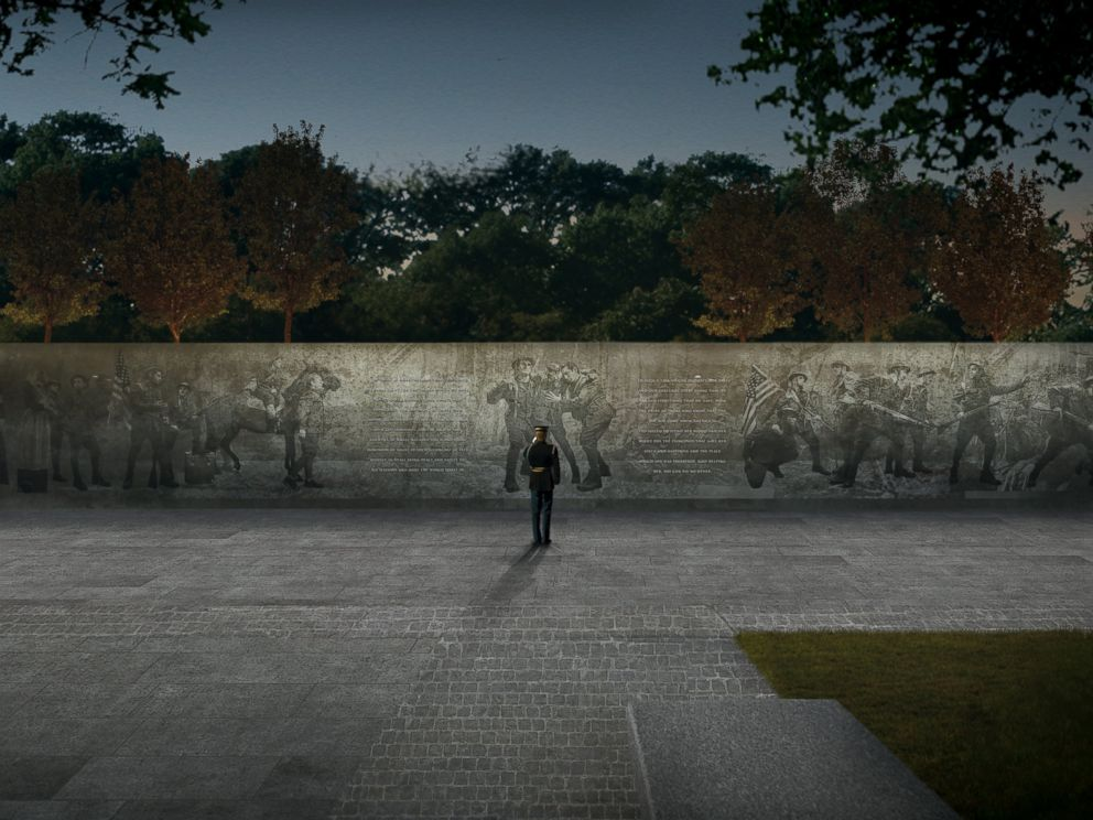 PHOTO: A soldier salutes a panel depicting battle scenes from World War I in this architectural rendering of the winning design, The Weight of Sacrifice.