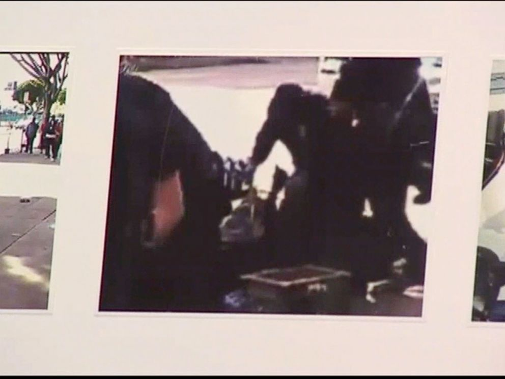 PHOTO: LAPD chief Charlie Beck showed video stills from footage shot by onlookers that he alleges shows the man reaching for the police officers weapon.