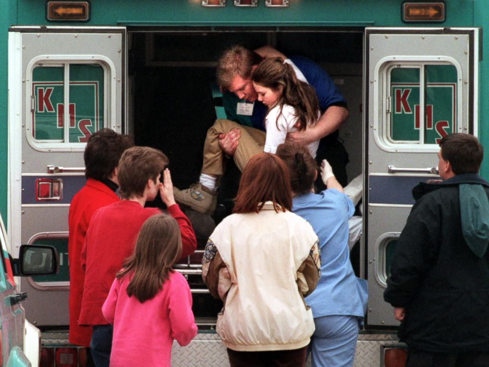 PHOTO: An emergency worker carries a young girl from an ambulance outside Westside Middle School in Jonesboro, Ark., Mar. 24, 1998. Four classmates and a teacher were killed when Mitchell Johnson and Andrew Golden opened fire at the school.