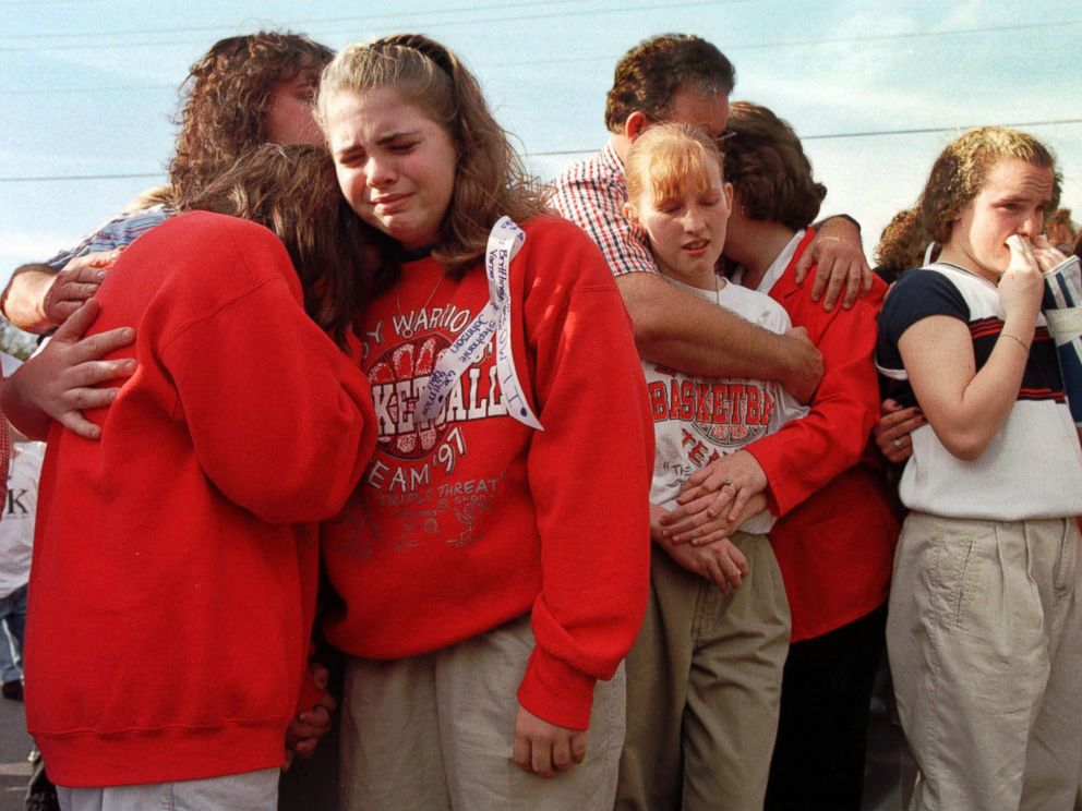 PHOTO: Westside Middle School students gathered in the parking lot of a radio station, March 26, 1998, to hear a tribute song to the children who died in a shooting at the school near Jonesboro, Ark.
