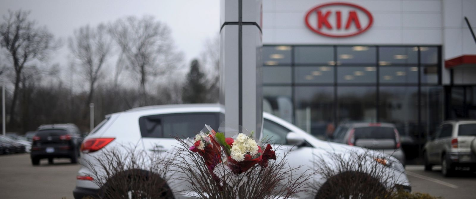 PHOTO: Flowers sit at a makeshift memorial outside Seelye Kia, one of the sites of a series of seemingly random shootings over the weekend that killed six in Kalamazoo, Michigan, Feb. 22, 2016.