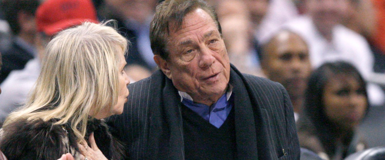 PHOTO: Los Angeles Clippers owner Donald Sterling sits with a companion as he watches the team play New York Knicks in Los Angeles, Feb. 11, 2009.