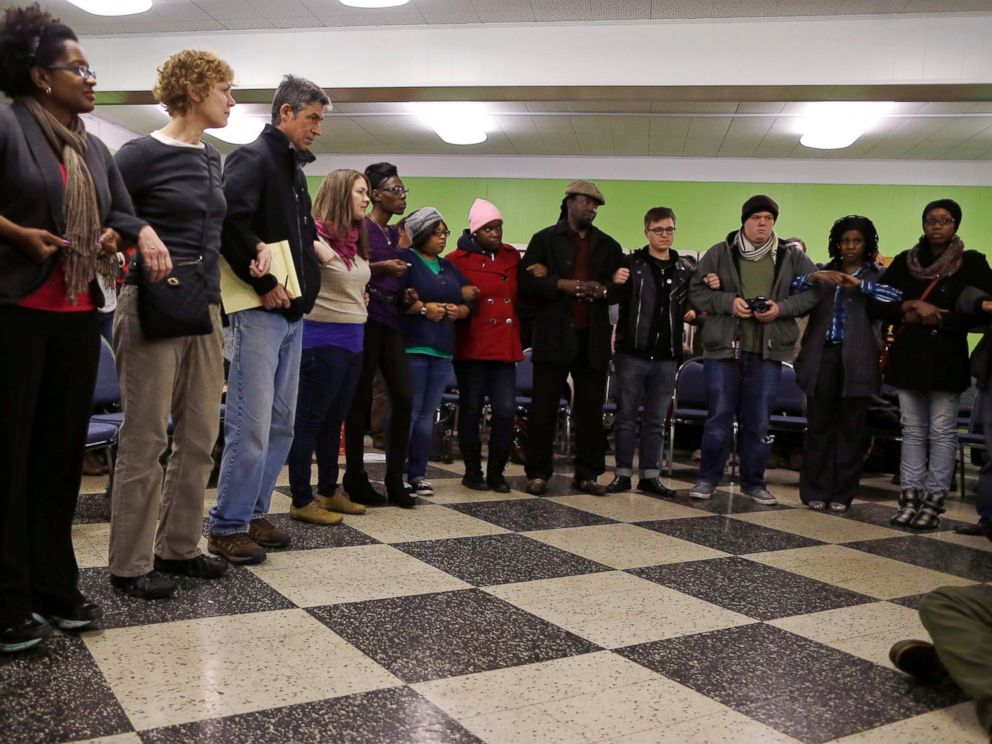 PHOTO: Participants link arms during a training session on how to hold a non-violent and peaceful demonstration, in preparation for the verdict by a Missouri grand jury on the fatal shooting of Michael Brown in St. Louis, Mo., Nov. 12, 2014.