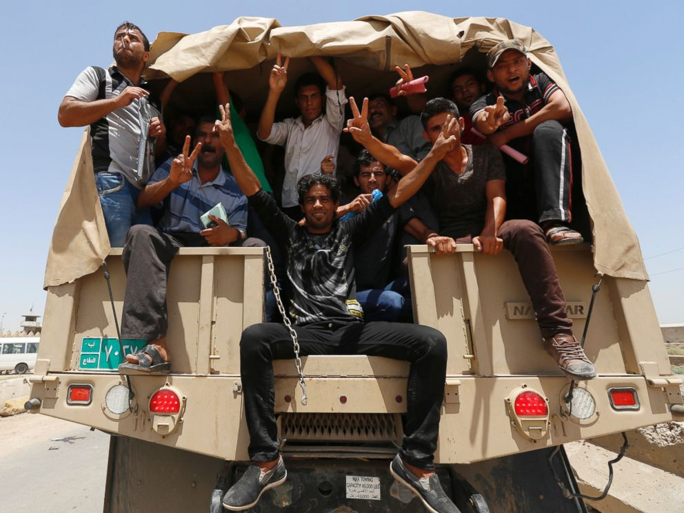 PHOTO: Volunteers, who have joined the Iraqi Army to fight against the predominantly Sunni militants who have taken over Mosul and other Northern provinces, travel in army trucks in Baghdad June 14, 2014.