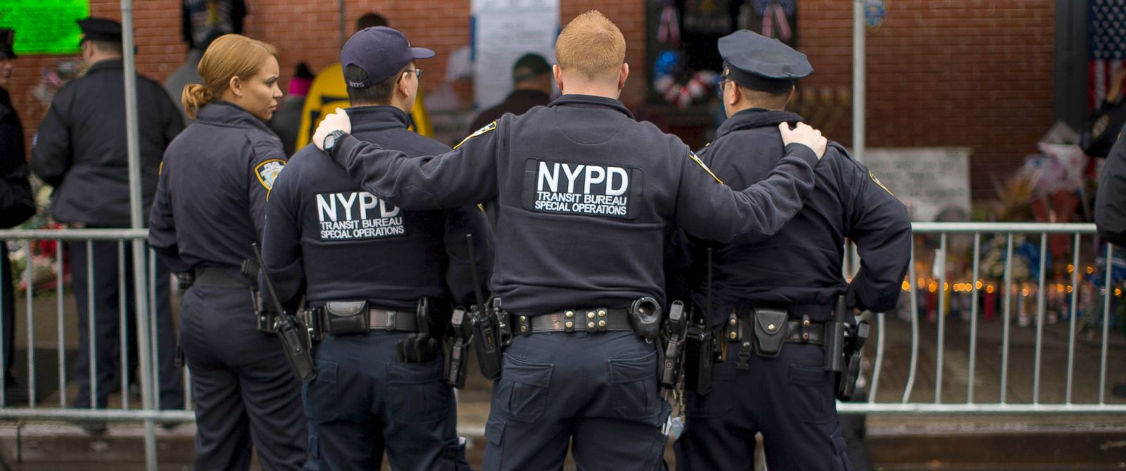 PHOTO:New York City Police officers pause as they visit a makeshift memorial at the site where two of their fellow police officers were fatally shot, Dec. 23, 2014, in Brooklyn, New York.