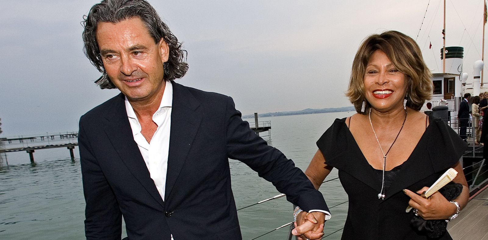 "PHOTO: Singer Tina Turner, right, and her long-term German partner Erwin Bach, arrive for the premiere of Giacomo Puccinis ""Tosca"" at Lake Constance in Bregenz, July 19, 2007."