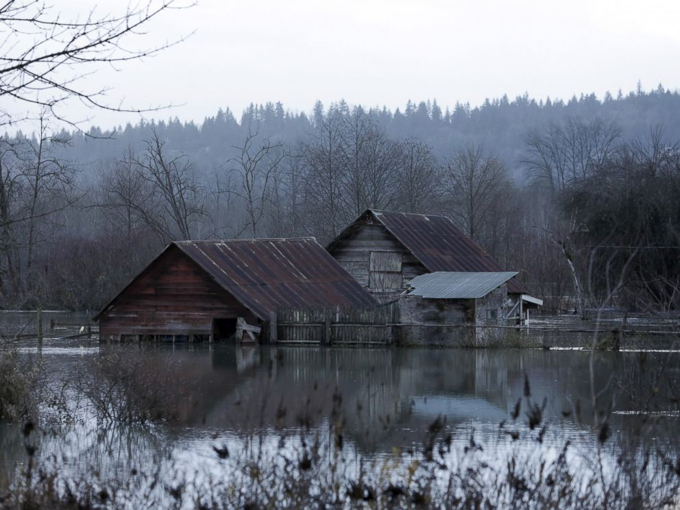 PHOTO:Flood waters of the Snoqualmie River surround a structure off State Route 203 during a storm in Carnation, Wash., Dec. 9, 2015.