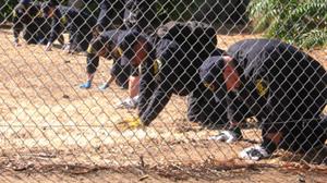 PHOTO Garrido investigators are shown on their knees.