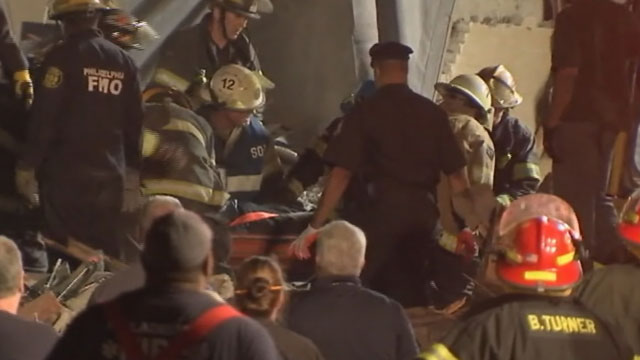 PHOTO: A 14th survivor was pulled from the rubble of a collapsed building in Philadelphia late Thursday night, June 5, 2013. The woman, identified as Myra Plekam, was rushed to the hospital minutes after officials raised the death toll to six people.