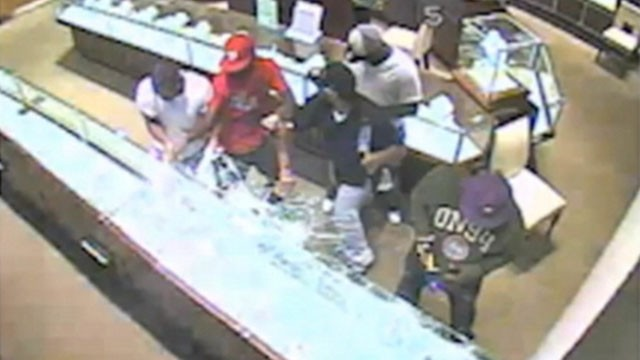VIDEO: Police release security footage of robbery at jewelry store in an Atlanta mall.