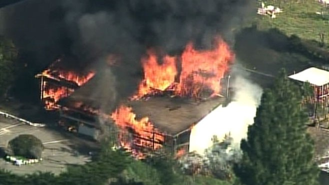 VIDEO: Authorities conduct a controlled burn of a house packed with explosive chemicals.