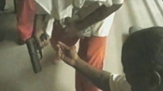 PHOTO: A video shown in court from Orleans Parish Prison shows prisoners allegedly with guns, and using drugs.