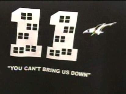 Video: High school bans t-shirt that mimics September 11 tragedy.