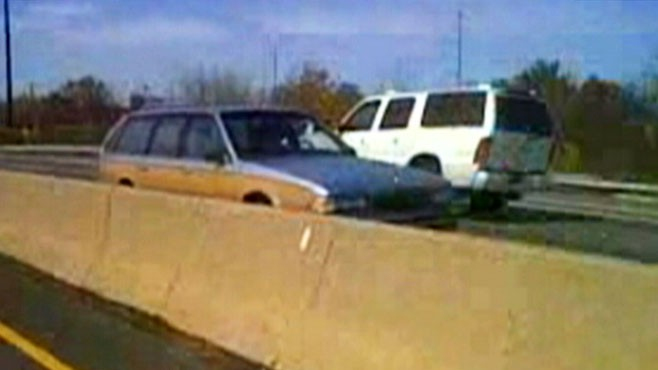 VIDEO: Cell phone camera captures elderly woman driving wrong way on the interstate.