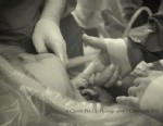 PHOTO:Baby Nevaeh Atkins holds Dr. Allan Sawyers hand from inside her mothers womb.