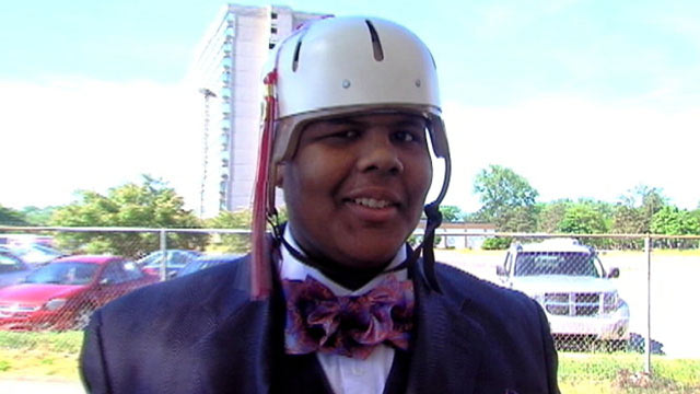 PHOTO: Cap: Balaal Hollings, who was shot in the head on April 6, was able to surprise his classmates at their high school graduation in Detroit on June 4, 2013.