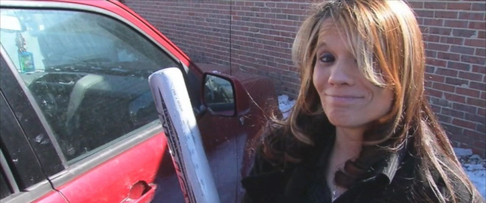 PHOTO: Jessica Farley used her sons baseball bat to bust down Charlie Cottrills car window to help rescue him from his car filled with exhaust fumes.