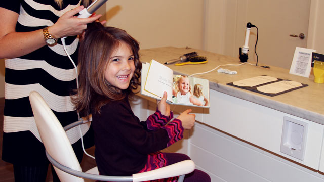 Five-year-old Lois gets her hair blown out at Drybar. Salons around the country are now catering to children, offering them high-end hair care services as well as manicures, pedicures and other treatments.