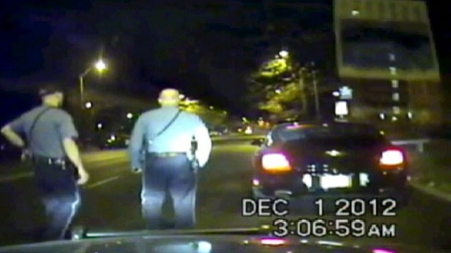 VIDEO: Footage shows cops approaching linebackers car the morning of murder-suicide.