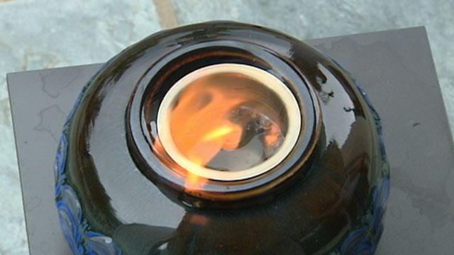 PHOTO: A ceramic fire pot blew up, splattering Michael Reyer with flaming gel fuel.