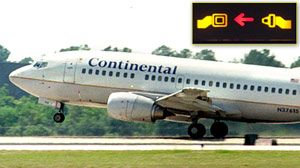 PHOTO A Continental Airlines 737 takes off from George Bush Intercontinental Airport in Houston, Texas in this file photo./Inset: A seatbelt sign is shown in this file photo.