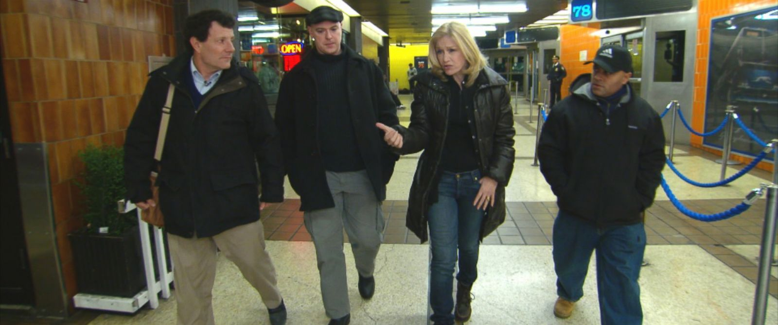 PHOTO: ABCs Diane Sawyer, center right, walks through a Port Authority bus terminal with New York Times journalist Nicholas Kristof, left, and Officer Jack Collins, center left, and Sgt. Hector Martinez, right.