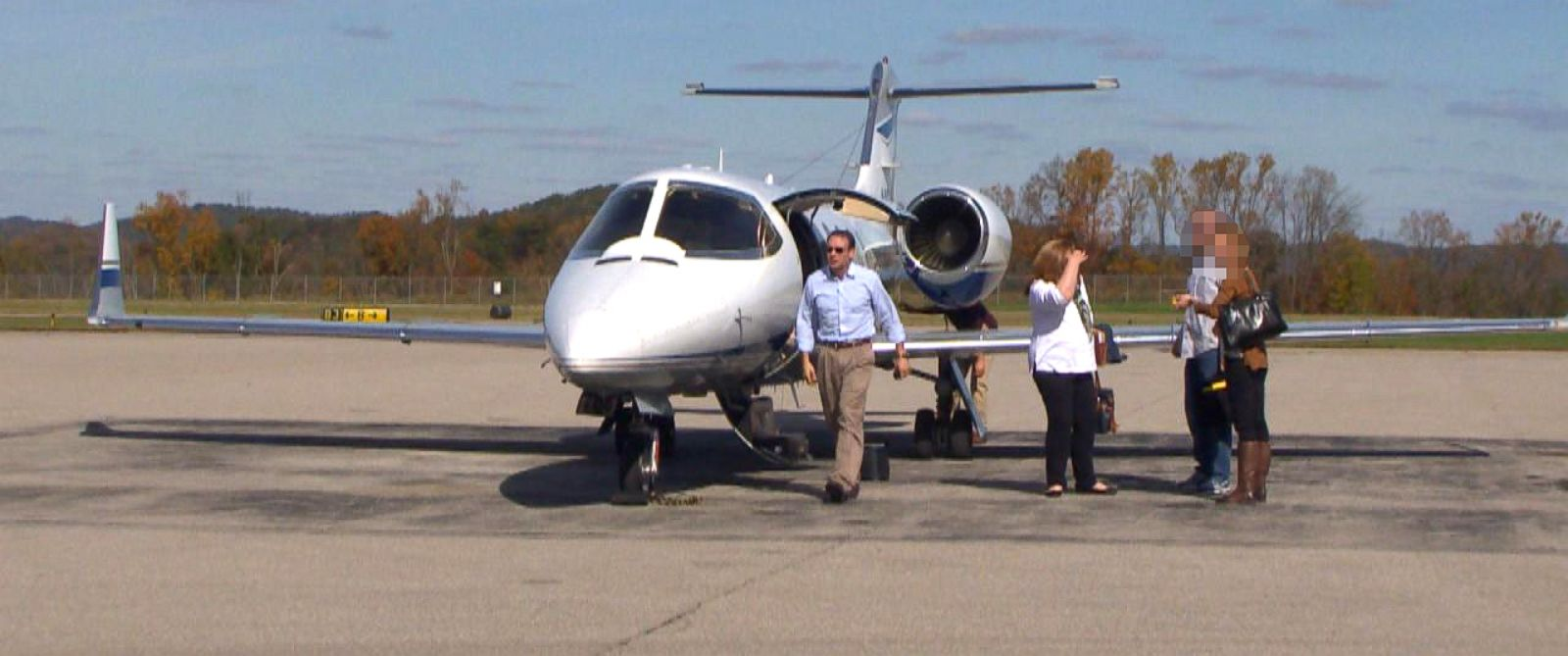 PHOTO: Attorney Michael Fuller, left, and colleagues arrive in West Virginia on Fullers private plane.