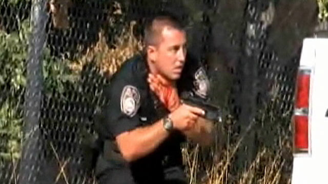 PHOTO: An El Cajon police officer was filmed as he was shot in the neck during a gun battle on Aug. 21, 2011.