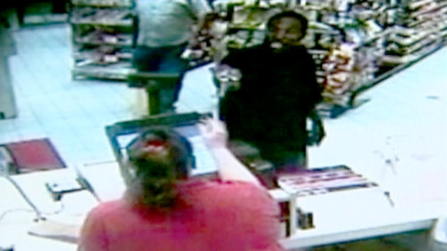 PHOTO: In this 2010 surveillance video, Ted Edmonds walked into a rural Virginia gas station during an armed heist, and hit the armed assailant with a beer bottle.
